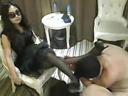 Chinese mistress uses two slaves
